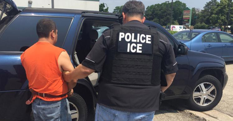 ICE agent making an arrest