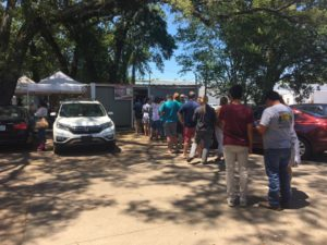 People wait in long line to order tacos