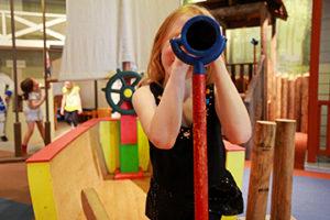 Girl looking through parascope