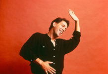 David Gonzalez dancing in orange backdrop