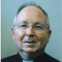 headshot of Father Altenbaugh