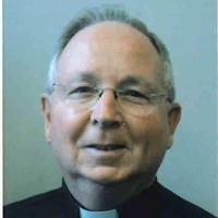 headshot of Father Altenbaugh