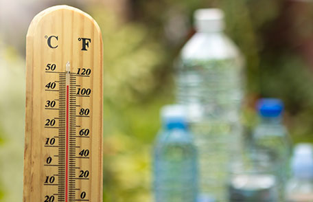outdoor thermometer and bottles of water