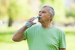 older man drinking water