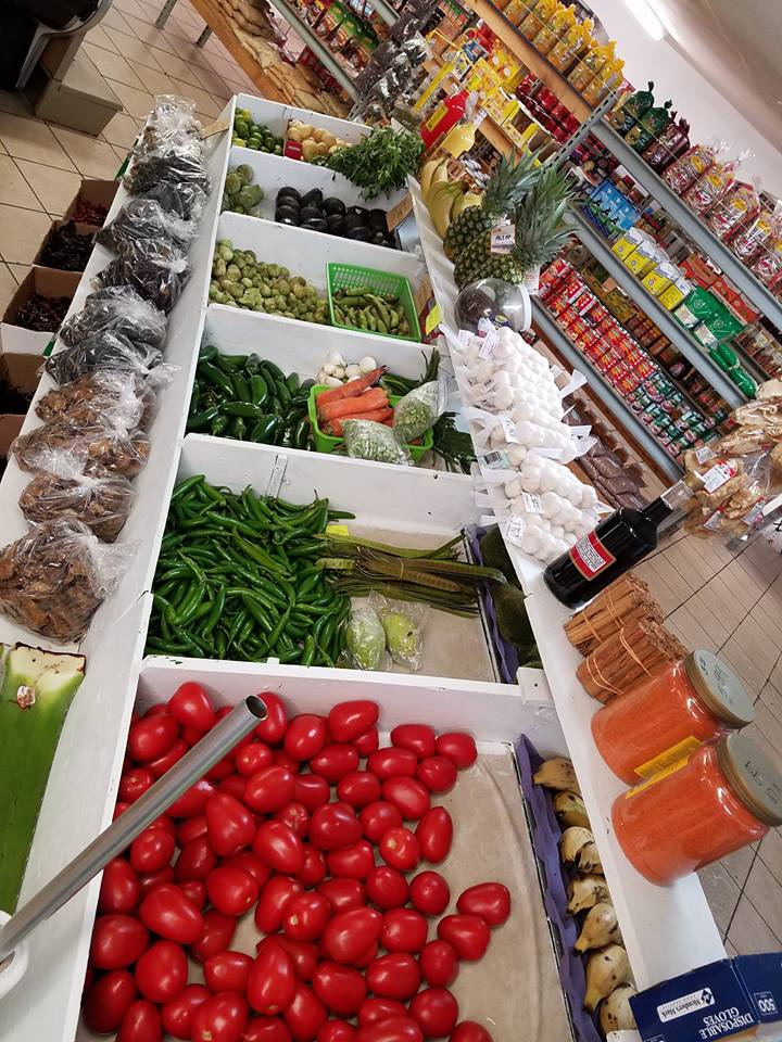 produce products inside store in wooden bins