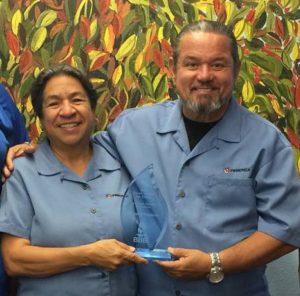 Margarita and Juan Vazquez holding award