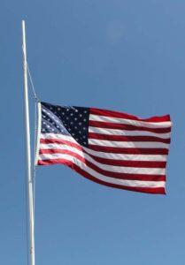 American flaga at half mast