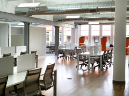 Office with chairs, tables amd windows