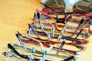 Row of multiple eye glasses on a table