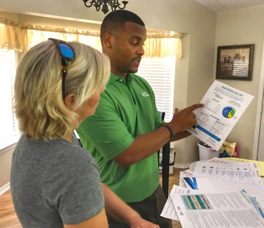 Man and woman looking at utility bill