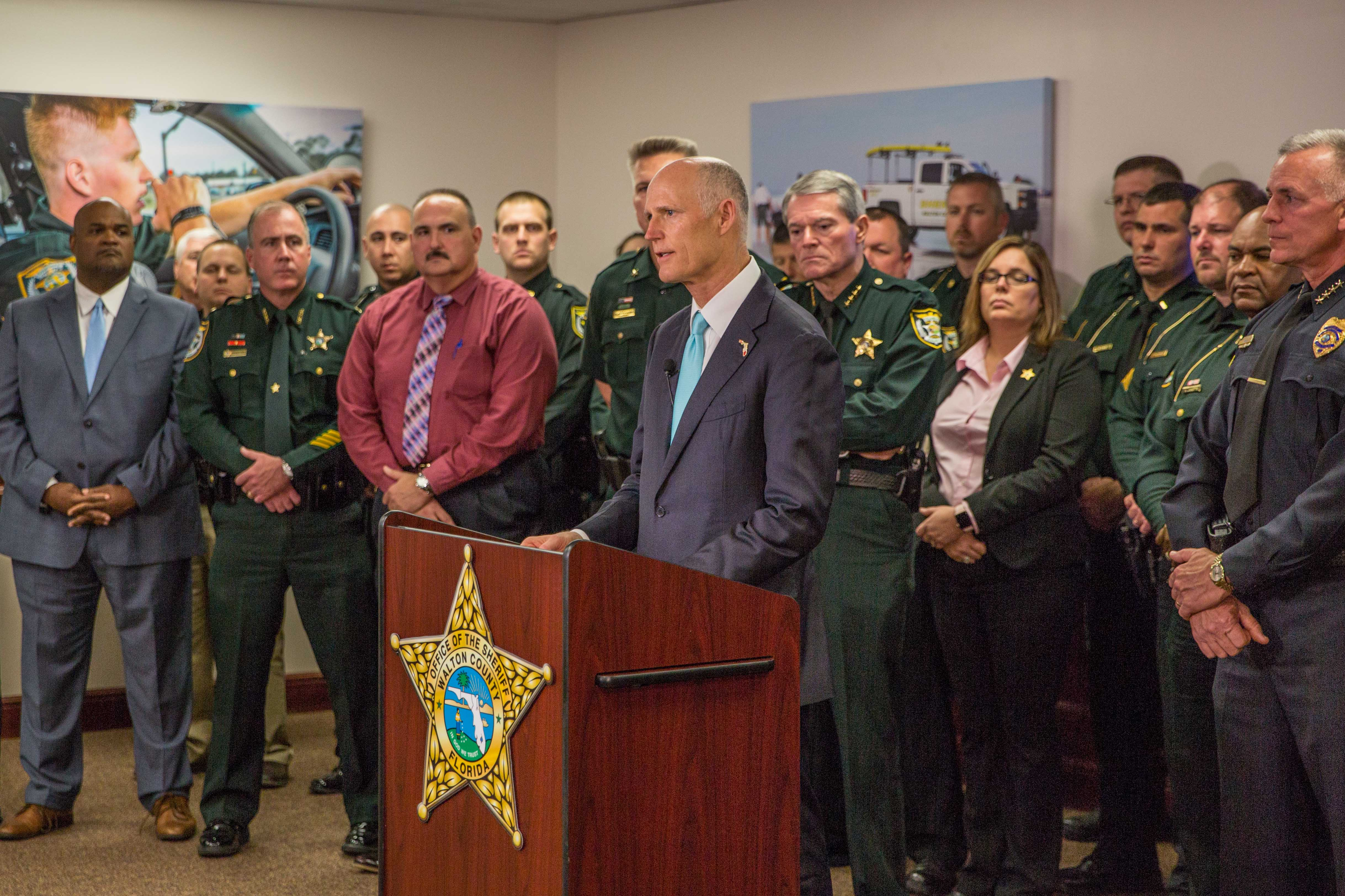 Florida Governor Scott standing with county sheriffs