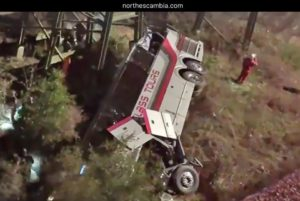 bus laying on its side inside rivine