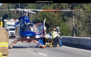 injured person being loaded onto helicopter