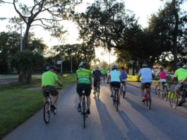 six people riding bicicles