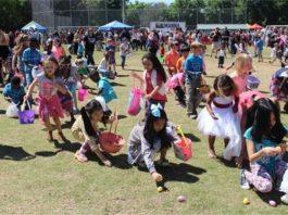 children picking up easter eggs