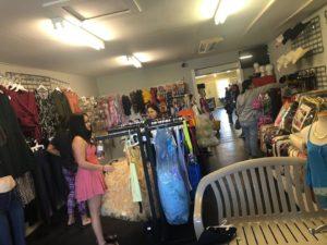 women shopping in clothing shop