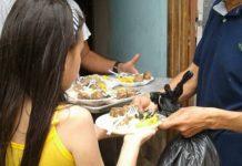 woman feeding girl