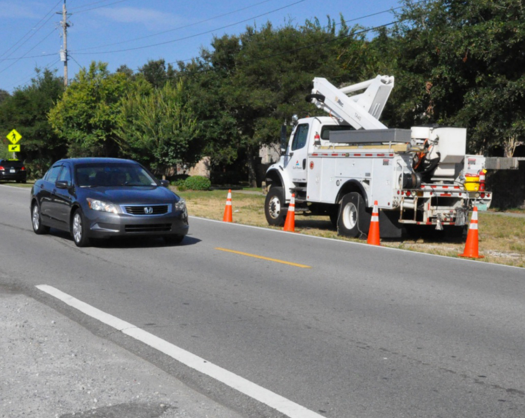 Traffic slowing for utility workers