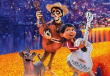 scene from animated film of boy and skeleton playing guitars with dog