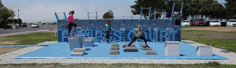 Outdoor gym equipment with people exercising