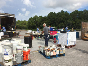 pallets of collected paint and chemical containers