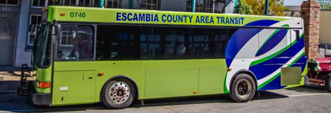 "green bus with words ""Escambia County Area Transit"""