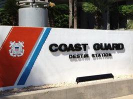 "building sign that says ""Coast Gurad Destin Station"""