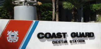 "building sign that says ""Coast Gurad Destin Station"""