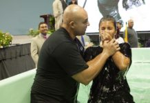 a young woman being baptized