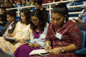 three women writing notes