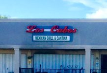 store front of los cabos restaurant with metal covers over windows
