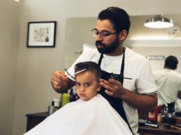 barber cutting boy's hair
