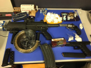 drugs, guns, bullets on a table