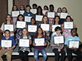 large group of students holding certificates