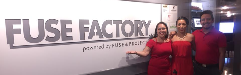 Three people standing in front of Fuse Factory sign