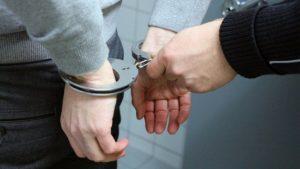 man's hands in handcuffs