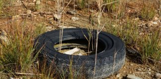 old tire in dirt and rocks