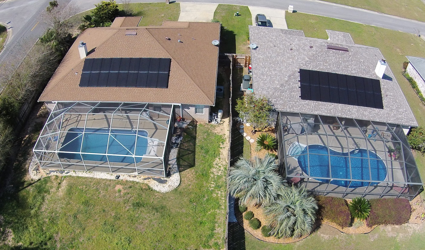Two adjacent homes with solar panels
