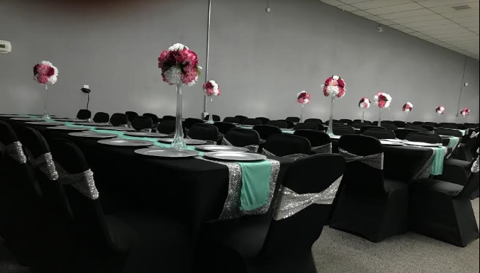 dance hall with decorated tables and chairs