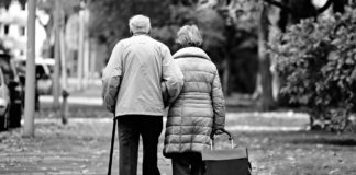 elderly couple walking in the cold