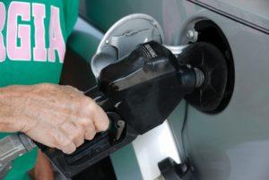 gasoline pump in car tank