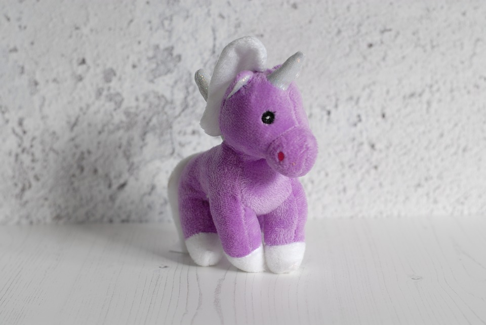 purple stuffed toy unicorn