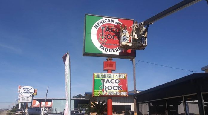 new business street sign that says taco rock