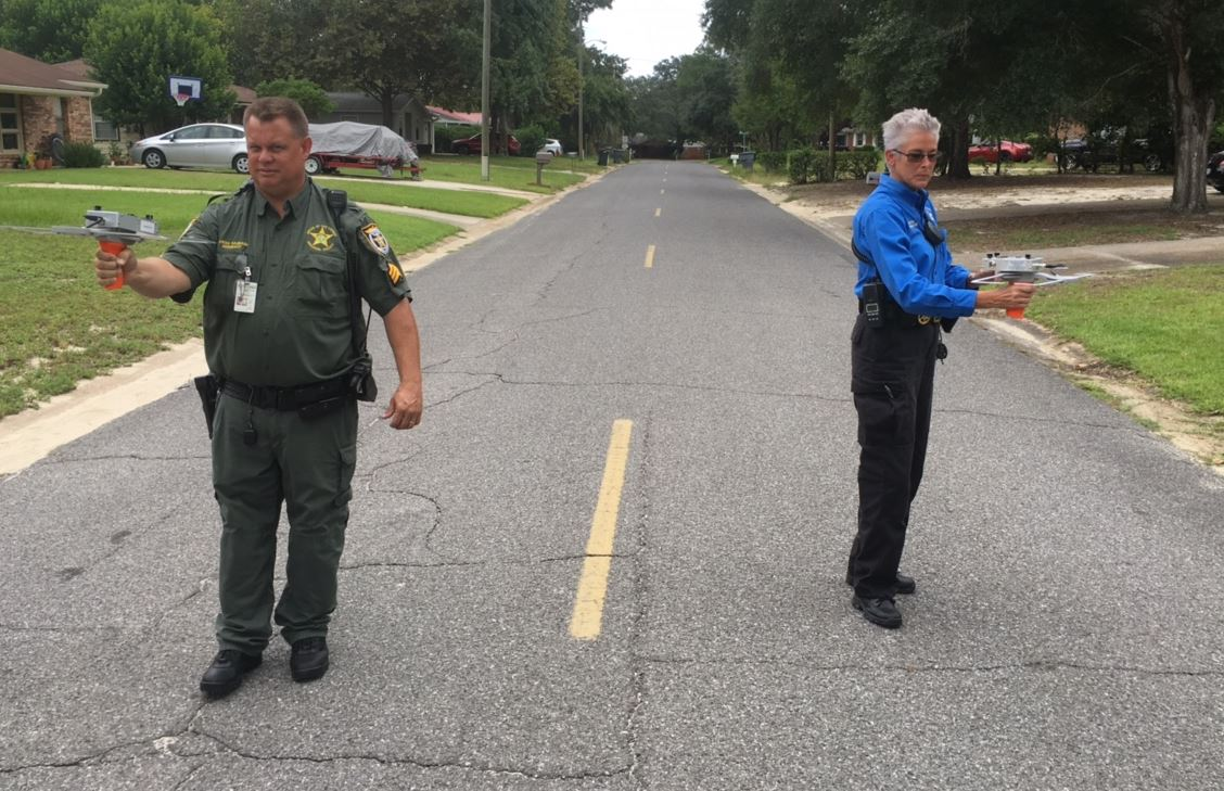 deputies on street using scanner