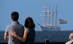 couple looking at elcano ship