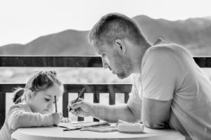 man helping child with homework