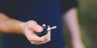 Man offering car key