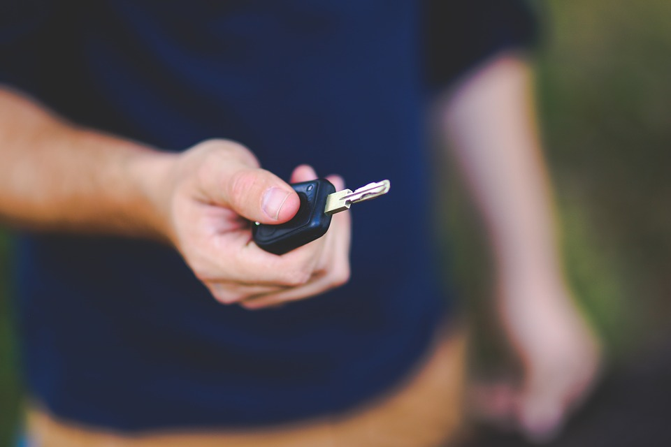 Man offering car key