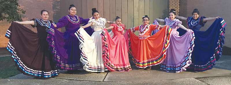 Jalisco dancers with colorful dresses extended
