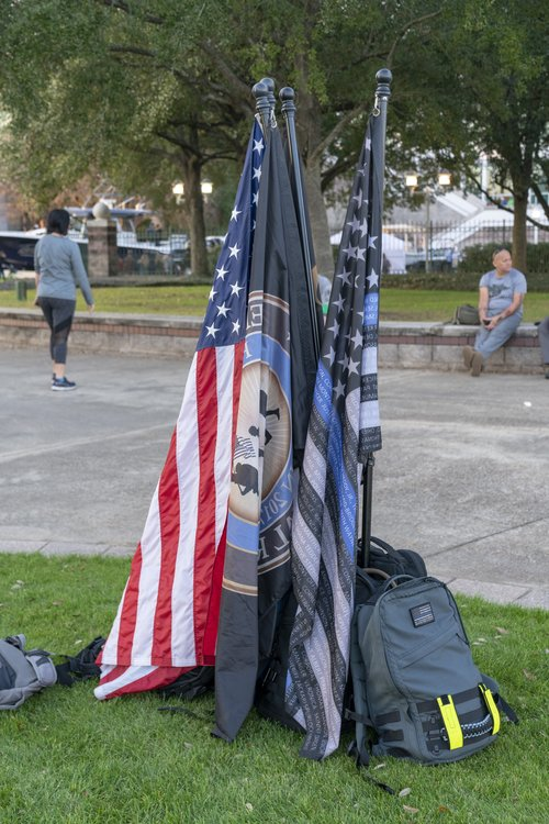 American and Police flag standing in park